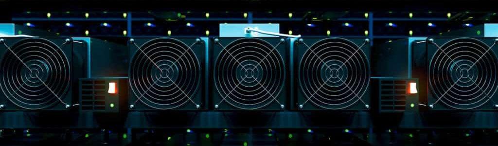 Line of black GPUs inside crypto mining farm
