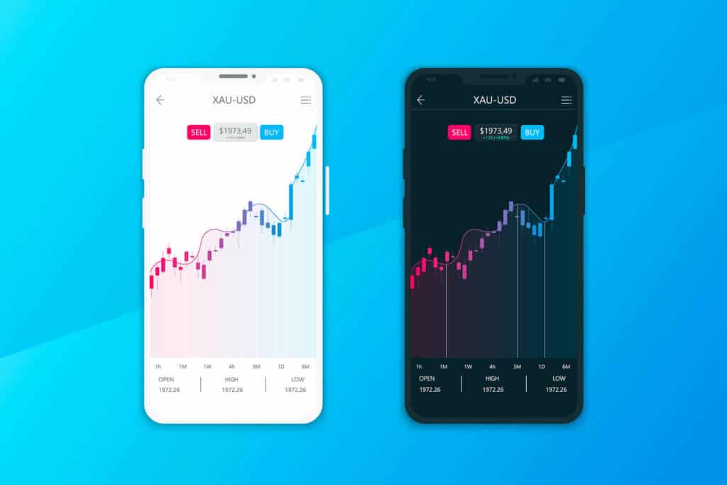 Cryptocurrency trading on two mobile phones on blue background