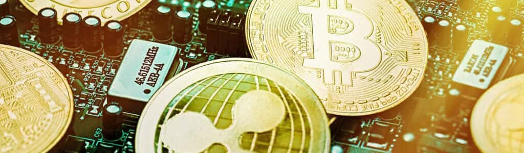 Popular cryptocurrency coins on top of circuit