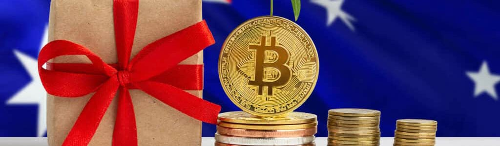 Stack of bitcoins beside wrapped gift on Australian flag